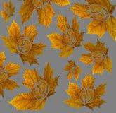 Αποκριές, φύλλα σφενδάμου μειώνονται με ένα εικονίδιο κολοκύθας σε ένα υπόβαθρο στοκ φωτογραφίες
