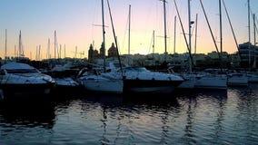 Απολαύστε το ηλιοβασίλεμα επάνω από Msida, Μάλτα απόθεμα βίντεο