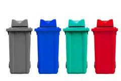 Απομονωμένα μεγάλα τέσσερα δοχεία απορριμάτων χρώματος με τη ρόδα Στοκ φωτογραφία με δικαίωμα ελεύθερης χρήσης