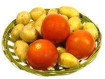 Απομονωμένες πατάτες και ντομάτες Στοκ Εικόνες