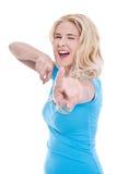 Απομονωμένη ξανθή ελκυστική υπόδειξη γυναικών Στοκ εικόνα με δικαίωμα ελεύθερης χρήσης