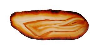 Απομονωμένη φέτα πολύτιμων λίθων αχατών ορυκτή Στοκ φωτογραφία με δικαίωμα ελεύθερης χρήσης
