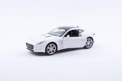 Απομονωμένο άσπρο πρότυπο αυτοκινήτων πολυτέλειας σε ένα άσπρο υπόβαθρο Στοκ Εικόνες