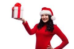 Απομονωμένο δώρο Χριστουγέννων λαβής γυναικών Santa Χριστουγέννων καπέλο Στοκ εικόνα με δικαίωμα ελεύθερης χρήσης