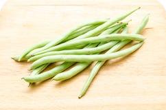 απομονωμένο λευκό ουσιών συμβολοσειράς φασολιών ανασκόπησης τρόφιμα Στοκ εικόνα με δικαίωμα ελεύθερης χρήσης