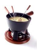 Απομονωμένο ελβετικό fondue τυριών σε ένα δοχείο σε έναν καυστήρα Στοκ Εικόνες