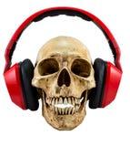 Απομονωμένο κρανίο με το κόκκινο ακουστικό Στοκ εικόνα με δικαίωμα ελεύθερης χρήσης