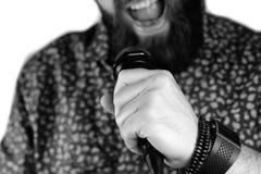 Απομονωμένο μικρόφωνο χέρι ατόμων Στοκ Εικόνες