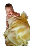 Απομονωμένο μωρό στο κίτρινο κάλυμμα Στοκ Φωτογραφία