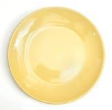 απομονωμένο πιάτο κίτρινο Στοκ Εικόνες