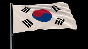 Απομονώστε τη σημαία της Νότιας Κορέας σε ένα κοντάρι σημαίας που κυματίζει στον αέρα σε ένα διαφανές υπόβαθρο, τρισδιάστατη απόδ απεικόνιση αποθεμάτων