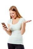 Αποστολή γυναικών sms στο τηλέφωνο κυττάρων, που απομονώνονται στο λευκό Στοκ φωτογραφία με δικαίωμα ελεύθερης χρήσης