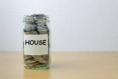 Αποταμίευση χρημάτων για το σπίτι Στοκ Εικόνες