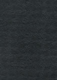 Αποτυπωμένο σε ανάγλυφο μαύρο υπόβαθρο σύστασης εγγράφου Στοκ Εικόνα