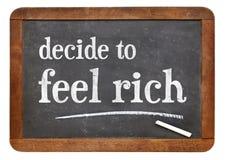Αποφασίστε να αισθανθείτε πλούσιος - πίνακας στοκ φωτογραφία