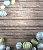 Απόδοση των αυγών Πάσχας στο ξύλινο υπόβαθρο στοκ φωτογραφίες