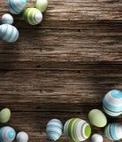 Απόδοση των αυγών Πάσχας στο ξύλινο υπόβαθρο στοκ εικόνα