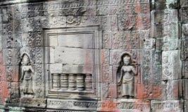 Απόκρυφη bas-ανακούφιση στους τοίχους της καμποτζιανής αρχαίας πόλης Ankgor Wat Στοκ φωτογραφίες με δικαίωμα ελεύθερης χρήσης