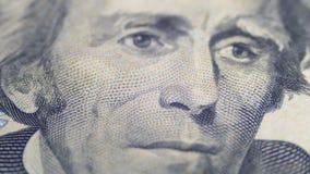Αργό περιστρεφόμενο πορτρέτο του Andrew Τζάκσον σε είκοσι δολάρια Μπιλ στη μακροεντολή φιλμ μικρού μήκους