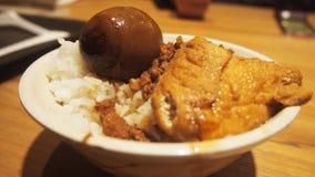 Αργό ρύζι χοιρινού κρέατος με το αυγό τσαγιού στοκ φωτογραφία με δικαίωμα ελεύθερης χρήσης