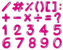 Αριθμοί και math σημάδια στο ρόδινο χρώμα Στοκ Εικόνες