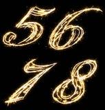 Αριθμοί πέντε, έξι, επτά, οκτώ, φιαγμένα από sparkler Απομονωμένος σε μια μαύρη ανασκόπηση στοκ εικόνα