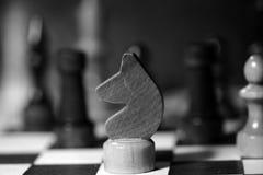 Αριθμοί σκακιού για μια σκακιέρα σε γραπτό Στοκ Φωτογραφίες