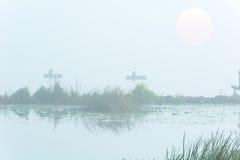 Αριθμοί των ψαράδων στην ομίχλη Στοκ Εικόνες