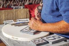 Αριθμοί χάραξης πετρών ατόμων Στοκ φωτογραφίες με δικαίωμα ελεύθερης χρήσης