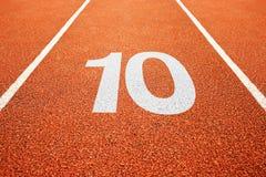 Αριθμός δέκα στο τρέξιμο της διαδρομής Στοκ Φωτογραφίες