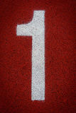 Αριθμός ένας στην έναρξη μιας τρέχοντας διαδρομής Στοκ Εικόνες