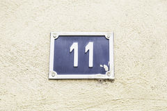 Αριθμός ένδεκα σε έναν τοίχο ενός σπιτιού Στοκ Φωτογραφίες