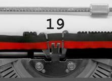 19 αριθμός από την παλαιά γραφομηχανή στη Λευκή Βίβλο Στοκ Εικόνα
