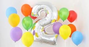 Αριθμός 2 δύο μπαλονιού χρώματος στο ελαφρύ υπόβαθρο Στοκ Εικόνα
