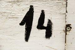 Αριθμός δεκατέσσερα στο ξύλο στοκ φωτογραφίες