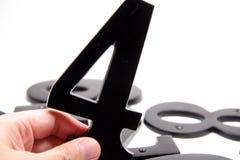 αριθμός εκμετάλλευσης 4 χεριών Στοκ φωτογραφία με δικαίωμα ελεύθερης χρήσης