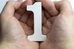 Αριθμός εκμετάλλευσης χεριών ένας Στοκ Εικόνες