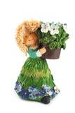 Αριθμός ενός κοριτσιού φιαγμένου από κεραμικό με ένα καλάθι των λουλουδιών Στοκ φωτογραφία με δικαίωμα ελεύθερης χρήσης