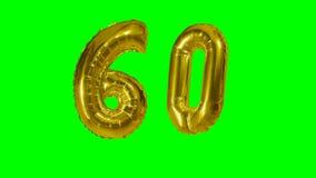 Αριθμός 60 εξήντα γενεθλίων χρυσών έτη μπαλονιών επετείου που επιπλέουν στην πράσινη οθόνη - φιλμ μικρού μήκους