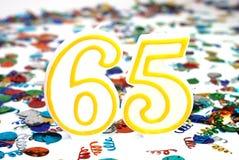αριθμός εορτασμού 65 κεριώ&nu Στοκ φωτογραφία με δικαίωμα ελεύθερης χρήσης