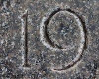 Αριθμός 19 που χαράζεται στο γρανίτη πετρών Στοκ Εικόνες