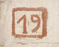 Αριθμός 19 σημάδι τοίχων Στοκ Εικόνα