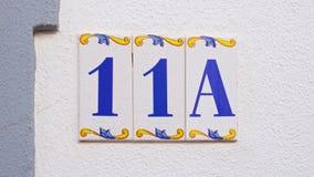Αριθμός σπιτιών κεραμικής στον τοίχο ένδεκα Στοκ φωτογραφίες με δικαίωμα ελεύθερης χρήσης