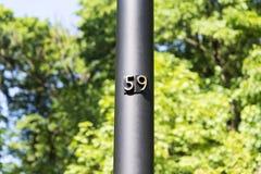 Αριθμός 59 αριθμός σπιτιών στον πόλο πενήντα εννέα Στοκ Εικόνα
