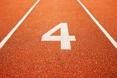 Αριθμός τέσσερα στο τρέξιμο της διαδρομής Στοκ φωτογραφία με δικαίωμα ελεύθερης χρήσης