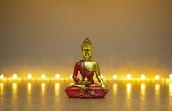 Αριθμός του Βούδα στην περισυλλογή με τα φω'τα κεριών Στοκ Φωτογραφίες