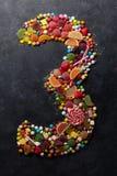 Αριθμός τρία που γίνεται από τις καραμέλες στοκ εικόνες