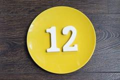 Αριθμός δώδεκα στο κίτρινο πιάτο Στοκ Εικόνα