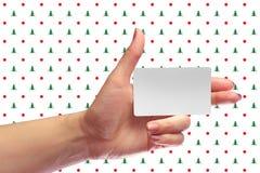 Αριστερό θηλυκό χεριών πρότυπο καρτών λαβής κενό άσπρο Δώρο Χριστουγέννων SIM Κάρτα καταστημάτων πίστης Πλαστικό εισιτήριο μεταφο Στοκ Φωτογραφίες