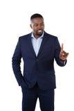 Αριστοκρατικός επιχειρηματίας που δείχνει το δάχτυλό του μιλώντας στοκ εικόνες